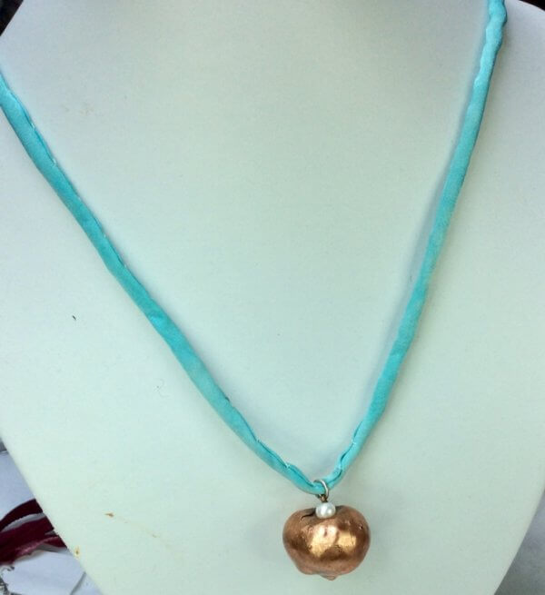 Copper electroformed conker, fresh water pearl, silk