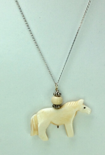 "Hand carved bone horse, sterling silver 16""chain"