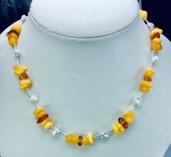 Baltic amber, freshwater pearl, sterling silver