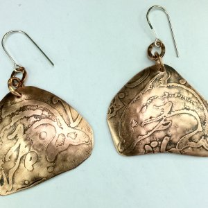 Copper etched dolphins, sterling silver