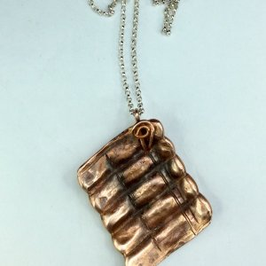 Copper ribbed pendant, sterling silver