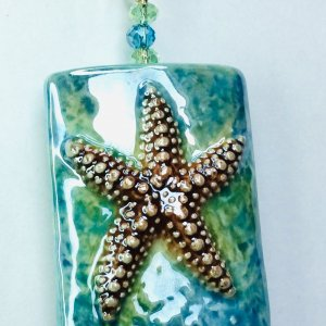 Porcelain starfish, crystal, sterling silver