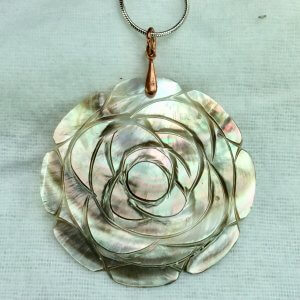 Carved shell, copper, sterling silver snake chain