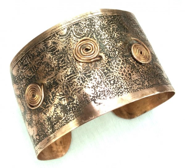 Copper etched bangle with pictish swirls