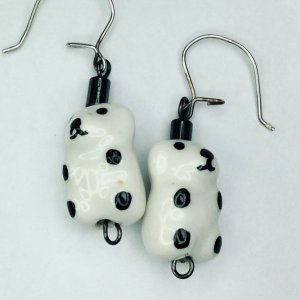 Porcelain bears, sterling silver