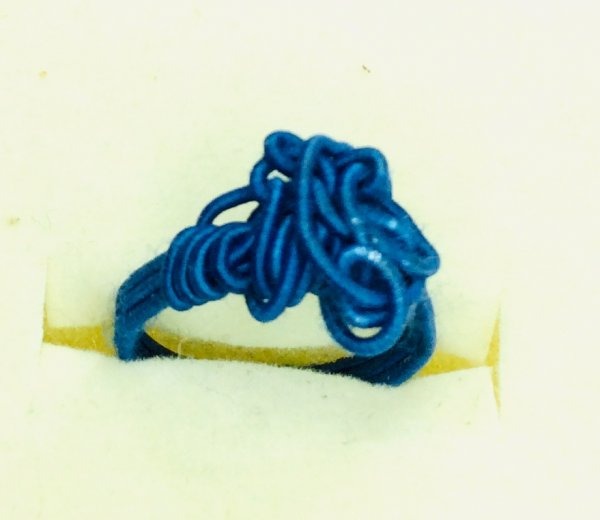 Blue silk covered artistic wire