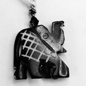 Wood, carved stylized elephant, electroplate hematite, crystal, sterling silver
