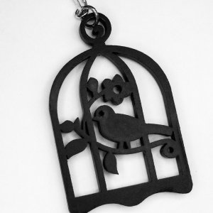 Wood carved indian, bird in cage, sterling silver