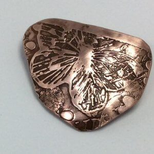 Etched copper butterfly brooch