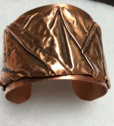 reformed copper bangle